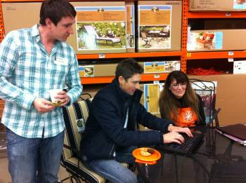 Antonio Lombardo looks on as James Danley signs up for his 2% Home Depot Rebate with Colleen